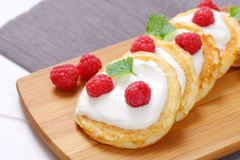 American pancakes with yogurt and raspberries Stock Photos