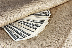 American Paper Currency Tucked Inside a Burlap Sack Stock Images