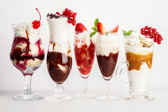American parfait. Delicious layered desserts in elegant bar glasses decorated with fresh berries. Sweet food Royalty Free Stock Photo