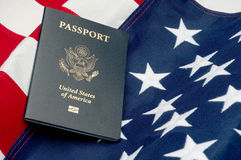 An American passport on an American flag stock photo