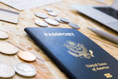 American passport and coins Royalty Free Stock Photography