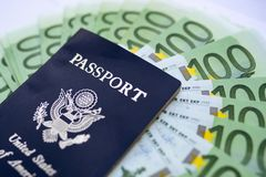 American passport with Euro bills royalty free stock photo