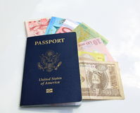 American passport and international currencies Stock Photography