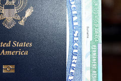 American passport, permanent resident card and social security number card. Are issued to the citizen or non-citizen nationals of the United States of America Royalty Free Stock Photo