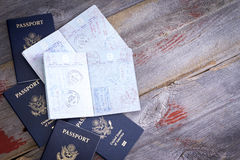 American passports open to reveal stamps stock photos