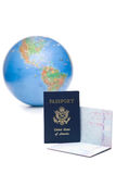 American passports stamped with travel visas in front. Two american passports stamped with travel visas, in front of out of focus world globe, over white Stock Photography