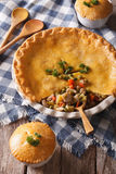 American pastries:  big Chicken pot pie on the table. vertical Royalty Free Stock Photos