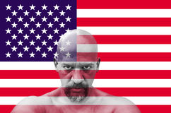 American patriot looking at you with USA flag in the background.  Royalty Free Stock Image