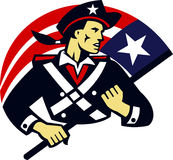 American Patriot Minuteman Flag Retro. Illustration of an american patriot minuteman militia revolutionary soldier holding usa stars and stripes flag done in Stock Photos