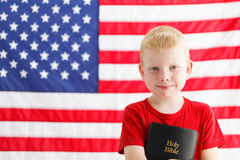 American patriotic boy with Holy Bible Stock Photos