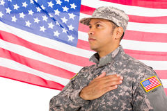 American patriotic soldier. Handsome american patriotic soldier with usa flag on background stock image