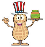 American Peanut Cartoon Character Holding A Jar Of Peanut Butter Royalty Free Stock Photos