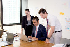 American people business team having using laptop during a meeting. Royalty Free Stock Images