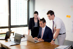 American people business team having using laptop during a meeting. Stock Photography