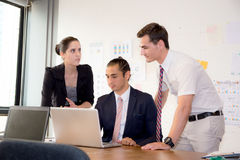 American people business team having using laptop during a meeting. Stock Images