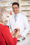 American pharmacist with senior woman in pharmacy Royalty Free Stock Photography