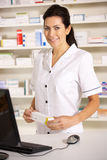 American pharmacist at work Royalty Free Stock Photo