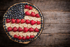 American pie. Sweet fruit and vanila pie with USA flag on the top,selective focus and blank space Royalty Free Stock Photos