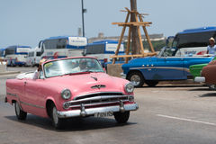 American pink classic car cabriolet drives on the promenade Malecon in Havana City Stock Photography