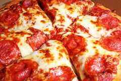 American Pizza closeup. Cheese salami sausage texture. Food photo. Royalty Free Stock Photo