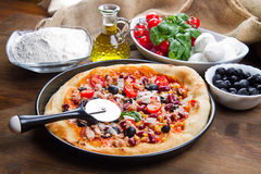 American pizza with salami,beans and mais Royalty Free Stock Image