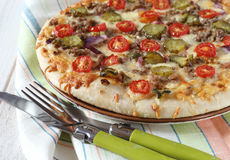 American pizza with tomatoes, pickles and minced meat Stock Photo