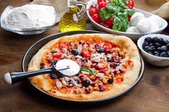 American pizza with tuna, red beans and mais Stock Photos