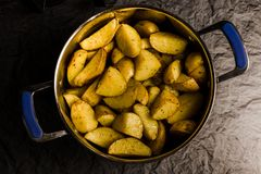 American potatoes with salt pepper and cumin in pan. royalty free stock images