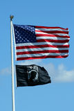 American and POW flags against a blue sky Stock Images