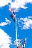 American and POW flags waving. American,  POW  and colorful marine signal flags wave on pole at the central mall at Jones Beach State Park, Long Island New York royalty free stock photography