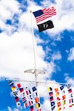 American and POW flags waving. American,  POW  and colorful marine signal flags wave on pole at the central mall at Jones Beach State Park, Long Island New York royalty free stock images