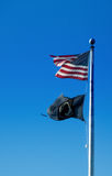American and POW-MIA flags. American flag and POW-MIA flag wave against a blue sky stock photography