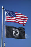 American and POW/ MIA flags in Brooklyn. BROOKLYN, NY - OCTOBER 20 : American and POW/ MIA flags in Brooklyn on October 20, 2013. The POW/MIA flag is a symbol of stock photography