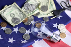 American power programm lamp coin money. Concept of different directions as the starting point for the implementation of ideas Stock Photography