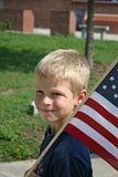 American Pride. Little boy with flag at War Memorial Stock Image