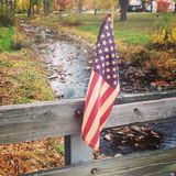 American pride. Old american flag on bridge Royalty Free Stock Photography