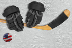 American puck, stick and gloves Royalty Free Stock Image