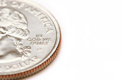 American quarter dollar macro - in god we trust. Over white Stock Photos