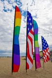 American and rainbow gay pride flags on the beach Stock Photography