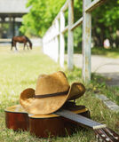 American ranch with cowboy hat and guitar Royalty Free Stock Photos