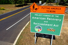 American Recovery and Reinvestment Act Road Sign. Work zone with American Recovery and Reinvestment Act sign at new road construction project site as part of the Stock Photos