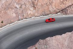 American red car. Red sports car on a road curve in Arizona, USA royalty free stock photography