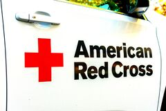American Red Cross sign on the side of white emergency and relief vehicle