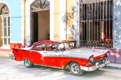 American red retro car in the street Stock Image