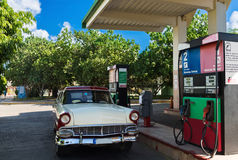 American red white classic car on the gas station in Varadero Cuba - Serie Cuba Reportage Royalty Free Stock Photography