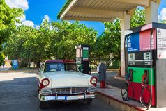 American red white classic car on the gas station in Varadero Cuba - Serie Cuba Reportage.  Royalty Free Stock Photography