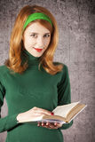 American redhead girl with book. Royalty Free Stock Photography