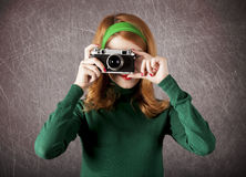 American redhead girl with camera. Stock Photography
