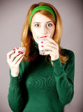 American redhead girl with milk and cake. Stock Images