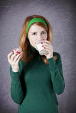 American redhead girl with milk and cake. Stock Image